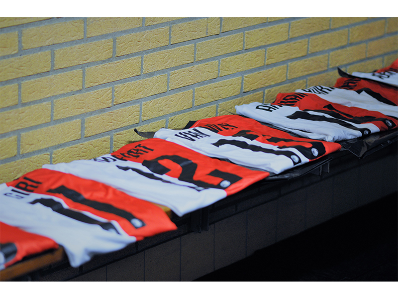 Photo of football shirts with the players name on.